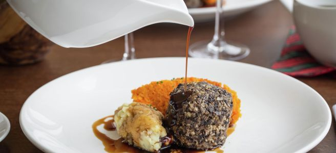 Haggis, neeps and tatties with a cream sauce